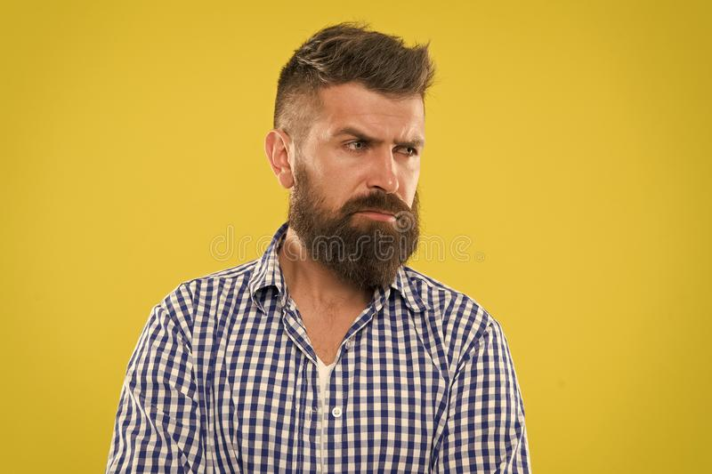 Hipster appearance. Beard fashion and barber concept. Man bearded rustic hipster stylish beard yellow background. Barber stock photography