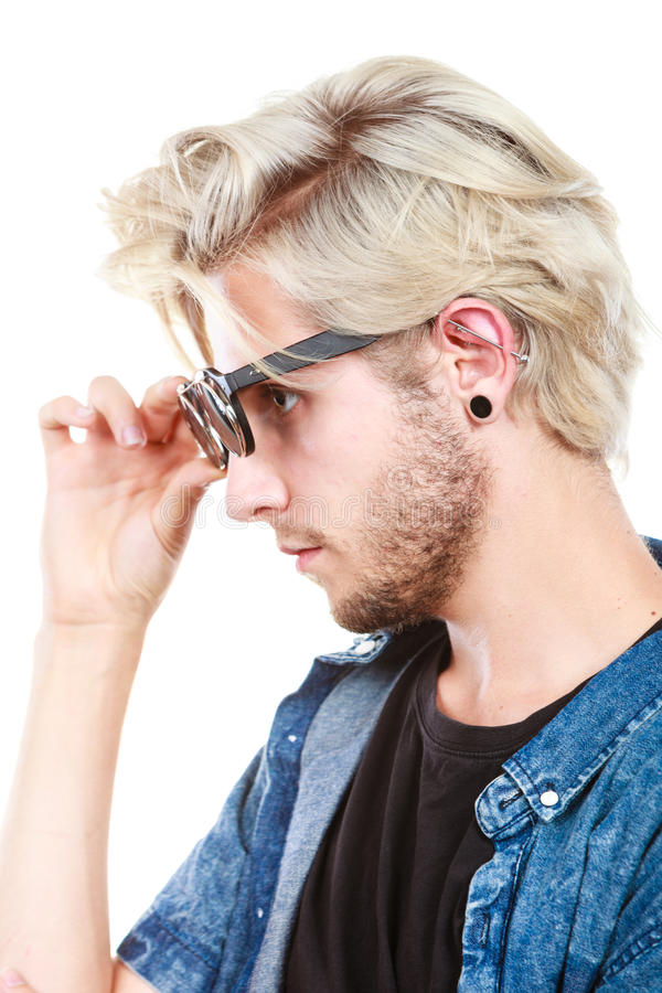 Hipster artistic man with sunglasses, profile portrait. Men fashion, accessories, hairstyle, modeling concept. Artistic hipster blonde man wearing and holding stock photography