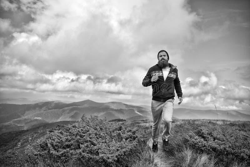 Hipster athlete, bearded man run on mountain landscape stock photos