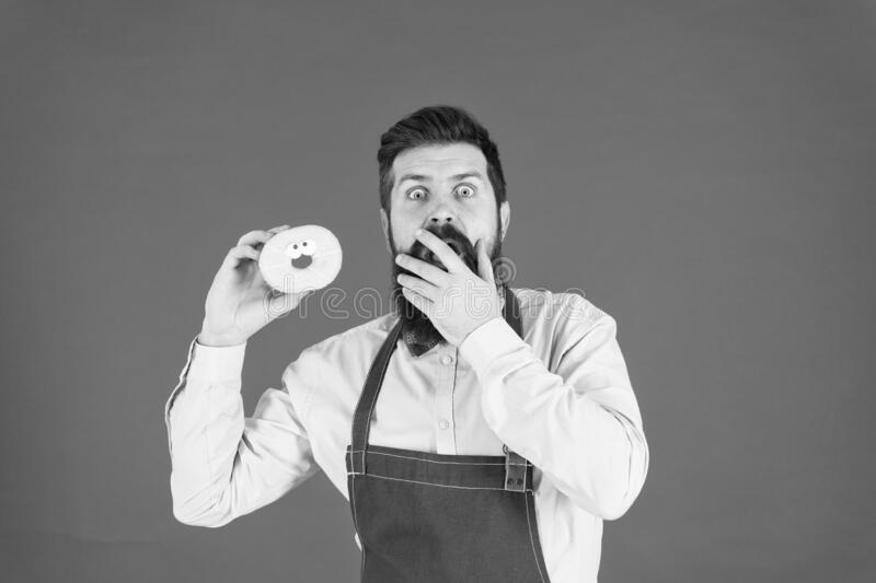 Hipster baker hold donuts. Cheerful mood. Doughnut calories. Glazed donut. Baked goods. Sweets and cakes. Junk food stock photography