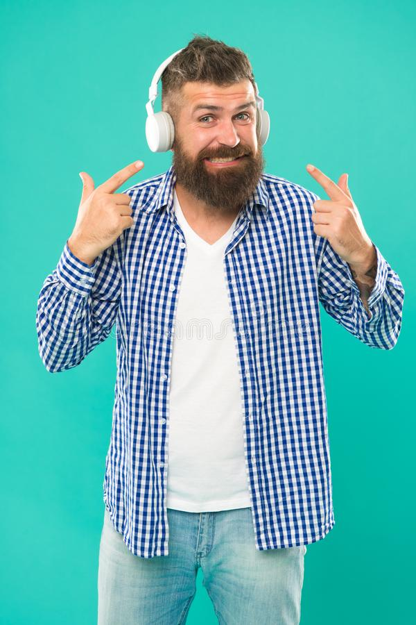 Hipster with beard listening music. Handsome music lover. Man in headphones. Streaming sites which we believe are royalty free stock image
