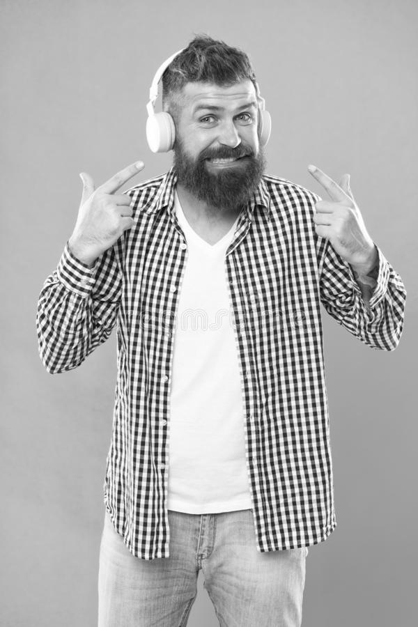 Hipster with beard listening music. Handsome music lover. Man in headphones. Streaming sites which we believe are royalty free stock photo