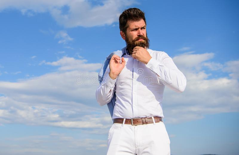 Hipster with beard and mustache looks attractive fashionable white shirt. Man bearded hipster formal clothes looks sharp. Sky background. Reached top. Guy enjoy royalty free stock image