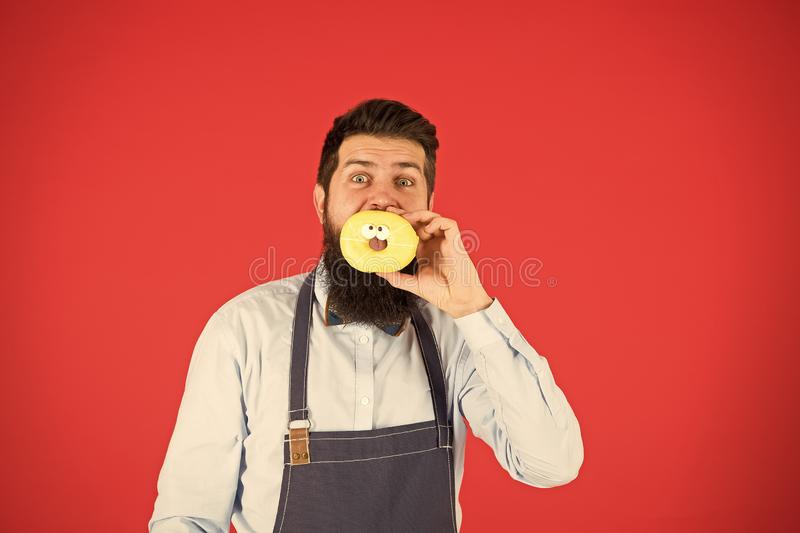Hipster bearded baker hold glazed donut on red background. True facts about sugar. No way. Cafe and bakery concept. Sweet donut from baker. Man bearded baker stock images