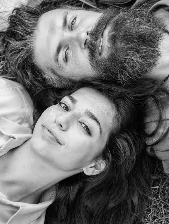 Hipster bearded man and girl happy carefree enjoy relax. Man unshaven and girl lay near top view. Feminine and masculine stock photos