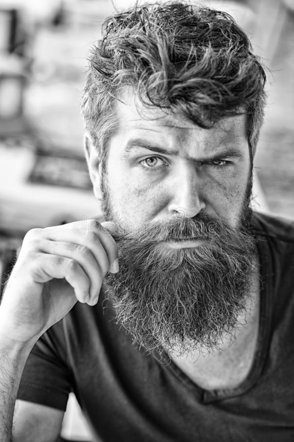 Hipster brutal guy twisting mustache. Man confident brutal bearded macho. Grooming and barber shop concept. Masculinity. And brutality. Male beauty. Macho royalty free stock images