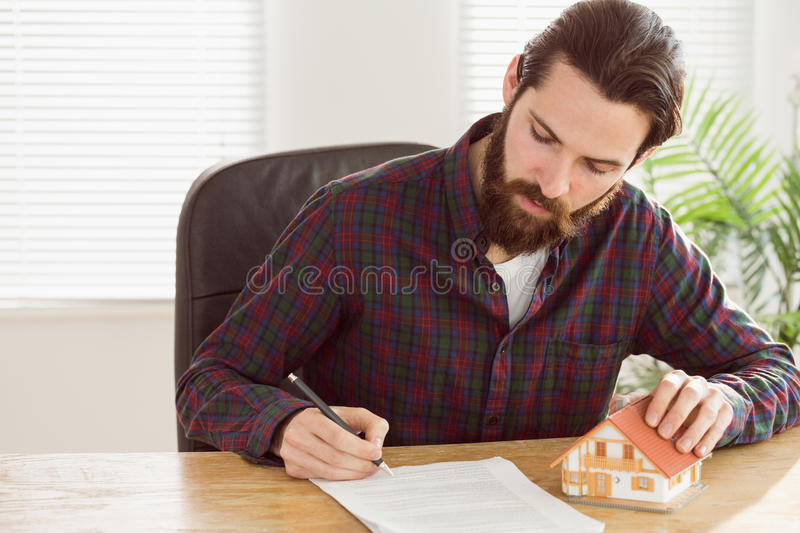 Hipster businessman applying for a mortgage royalty free stock photo