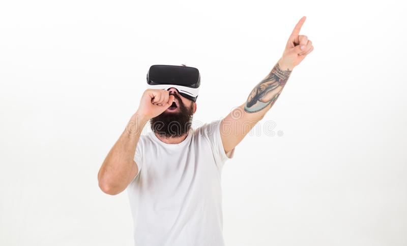 Hipster on busy face use modern technologies for entertainment or education. Man with beard in VR glasses, white stock images