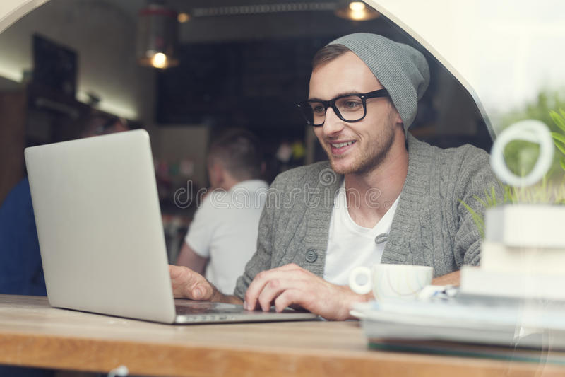 Hipster at cafe stock images