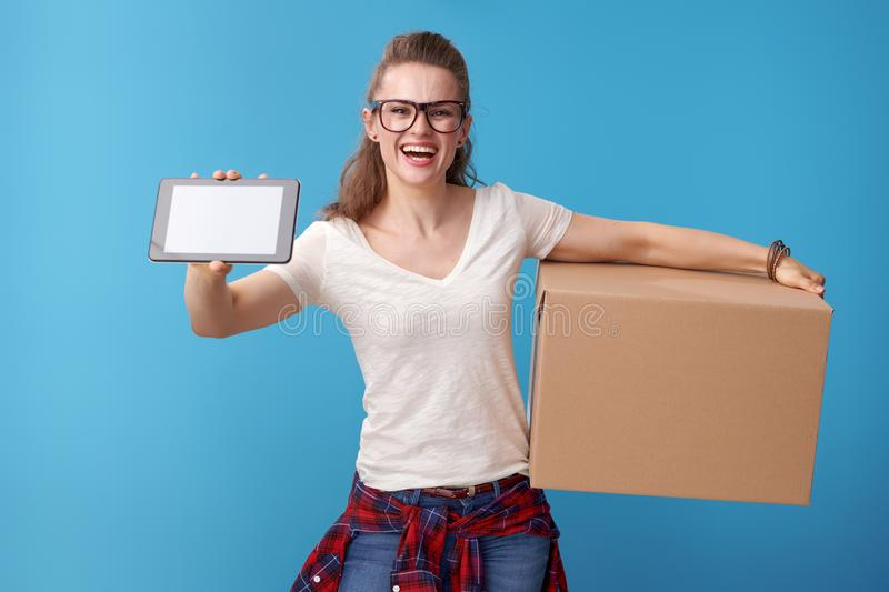 Hipster with a cardboard box showing tablet PC blank screen stock images