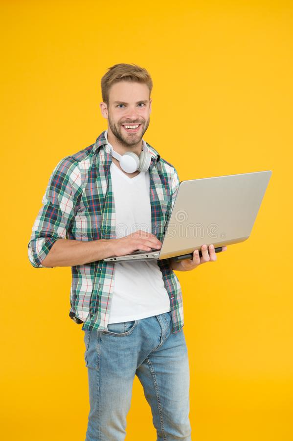Hipster cheerful bearded face holding laptop. Laptop computer repairman or tech worker. Notebook for work and. Entertainment. Guy enjoy modern technologies. Use stock photography