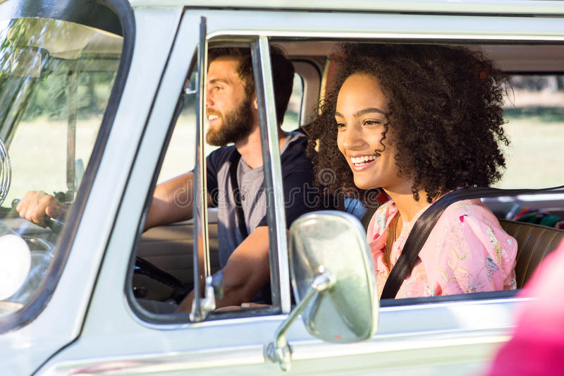 Hipster couple driving in camper van royalty free stock photography