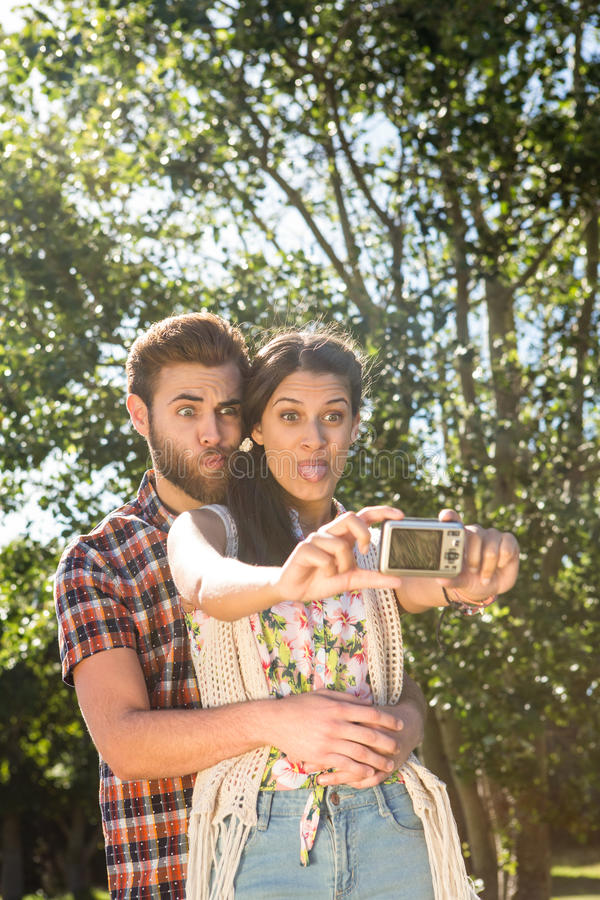 Hipster couple taking a selfie. On a summers day royalty free stock photos
