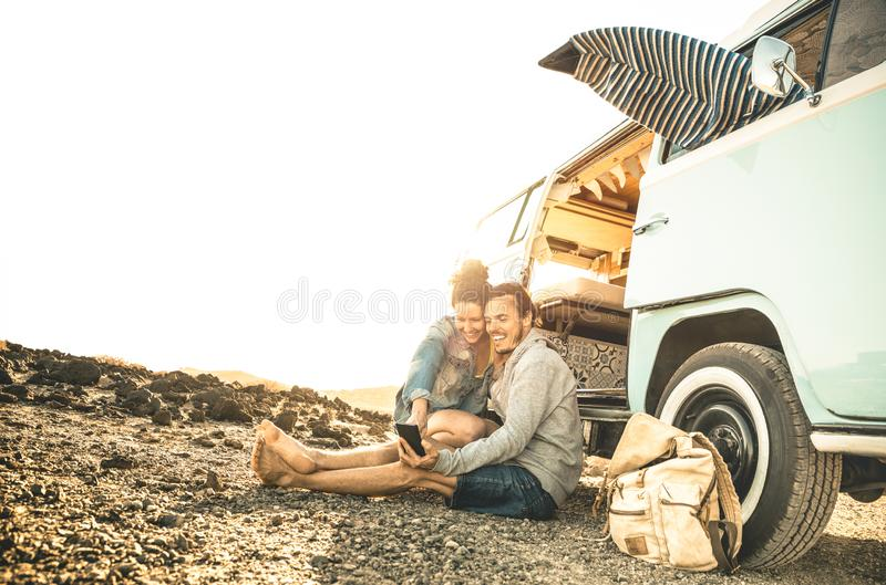 Hipster couple traveling together on oldtimer mini van transport royalty free stock photography