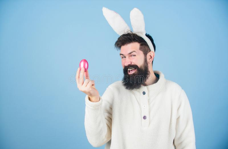 Hipster cute bunny long ears blue background. Easter bunny. Having fun. Funny bunny with beard and mustache hold pink royalty free stock images