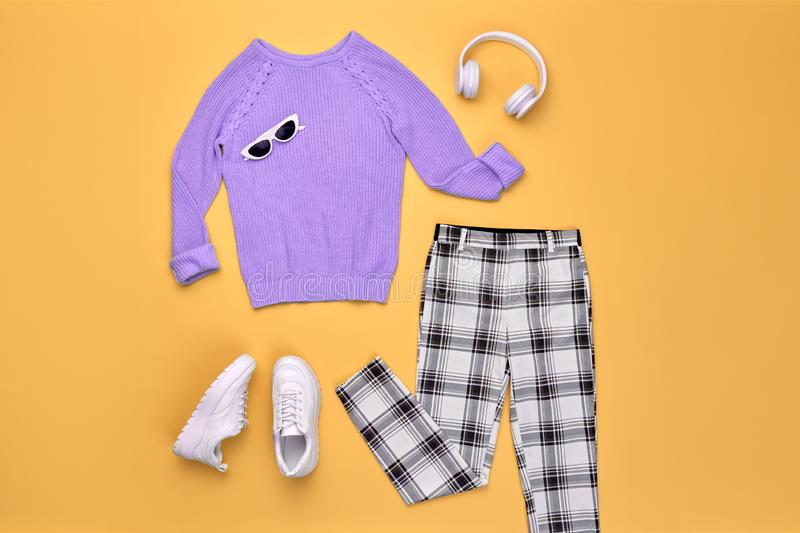 Autumn Fashion Hipster DJ Clothes Outfit Flat lay. Hipster DJ trendy colorful autumn Outfit. Fall fashion Flat lay. Purple jumper, Stylish sneakers, headphones royalty free stock photography