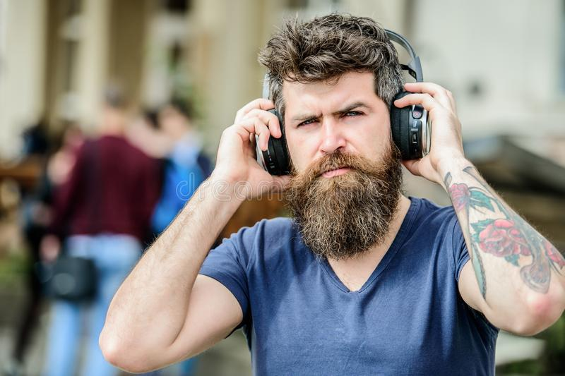 Hipster enjoy excellent sound song in earphones. Excellent music playlist. Walking with music. Music beat for energetic royalty free stock photography