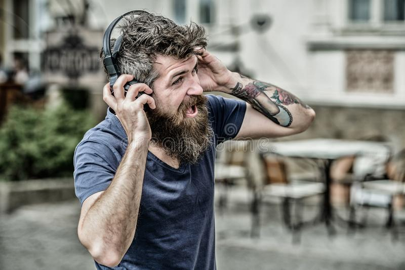 Hipster enjoy excellent sound song in earphones. Walking with music. Music beat for energetic mood. Rhythm for walk. Man stock photos