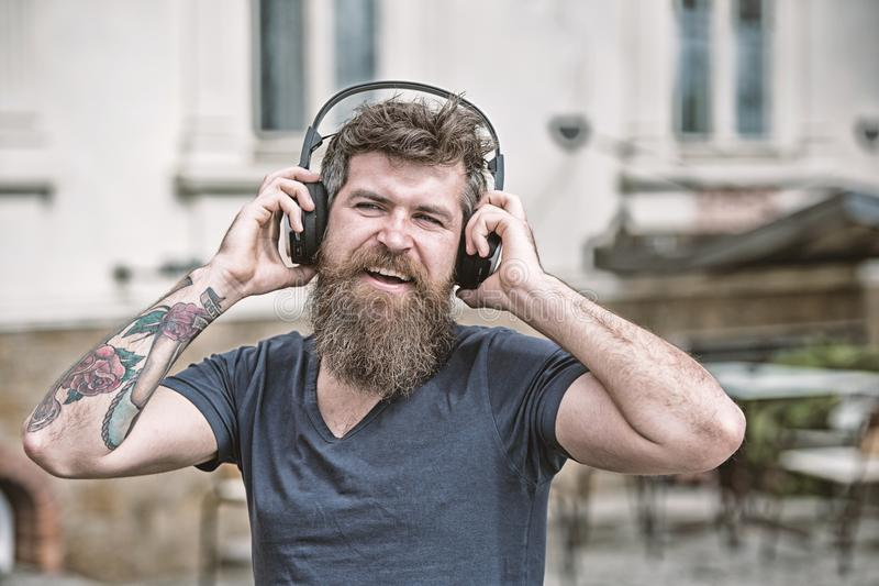 Hipster enjoy high quality sound of song in headphones. Get music subscription. Enjoy free songs everyday. Excellent stock photo
