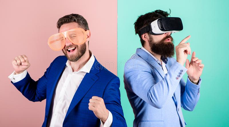 Hipster exploring virtual reality. Business implement modern technology. Real fun and virtual alternative. Man with. Beard in VR glasses and louvered plastic royalty free stock photography