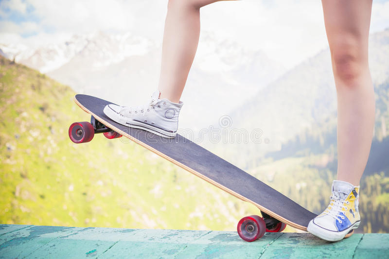Hipster fashion girl, relaxing, holding skateboar royalty free stock photography