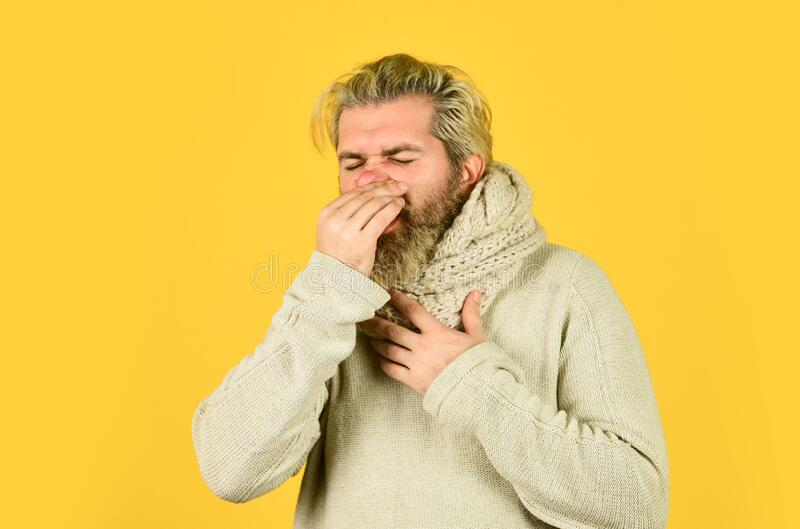 Hipster fever. Immune response. Bearded man sick. Warm scarf around neck. Cold flu fever concept. Body temperature. Fever and thermal regulation of immunity royalty free stock photos