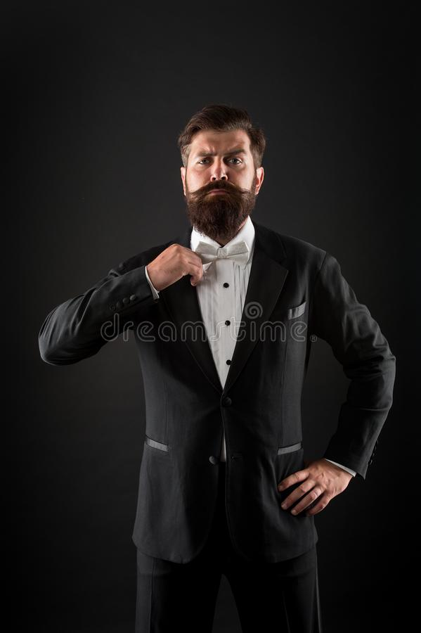 Hipster formal suit tuxedo. Difference between vintage and classic. Official event dress code. Classic style. Menswear. Classic outfit. Bearded man with bow tie stock images