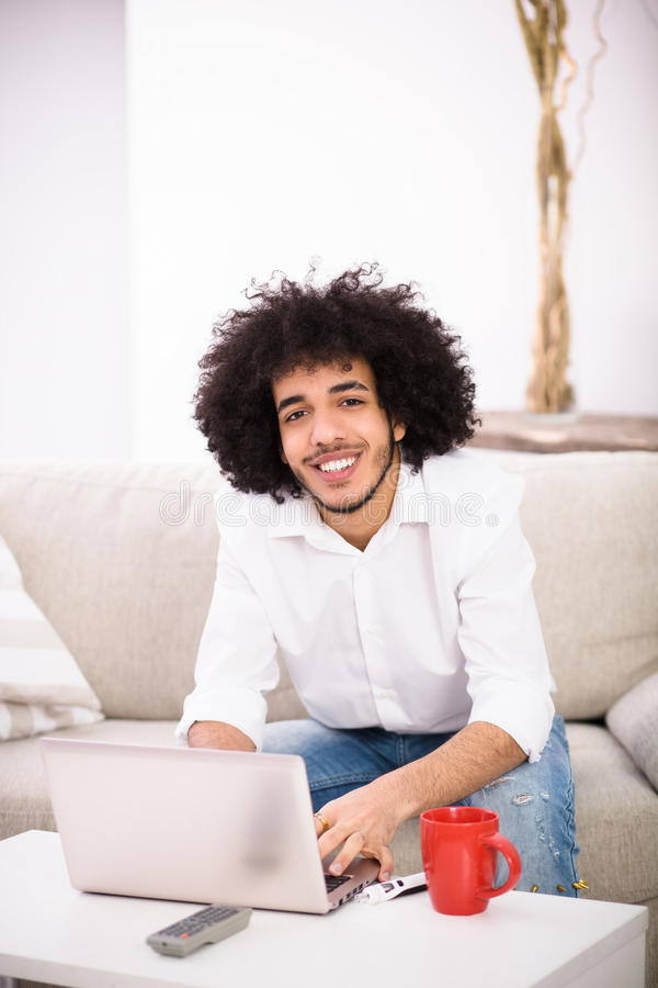 Hipster freelance man working at home royalty free stock photography