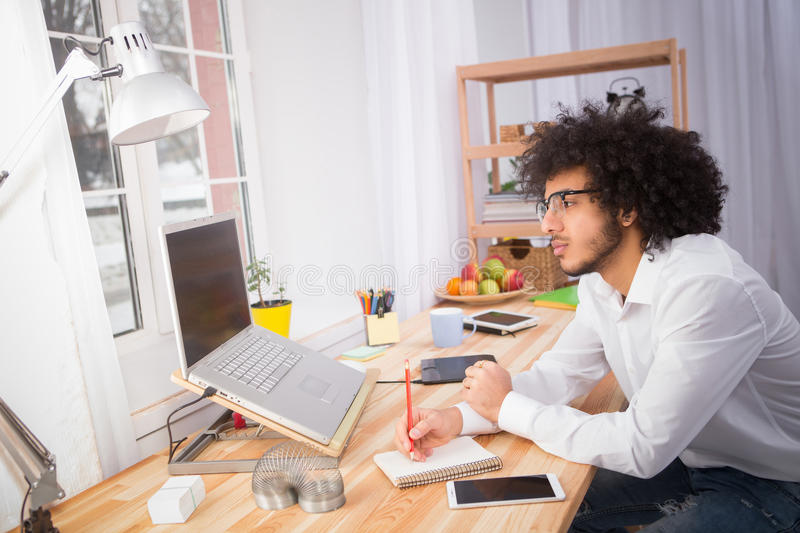 Hipster freelance man working at home stock image