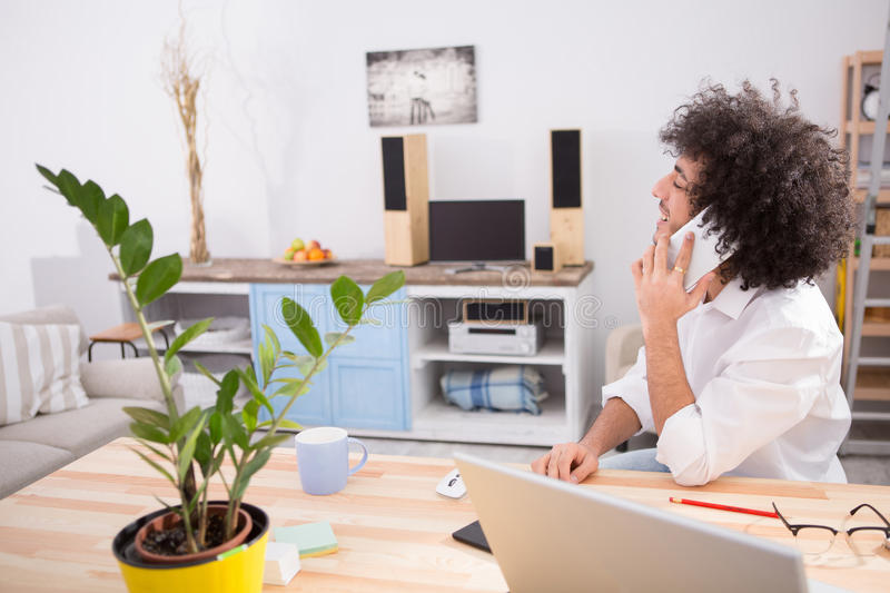 Hipster freelance man working at home royalty free stock image