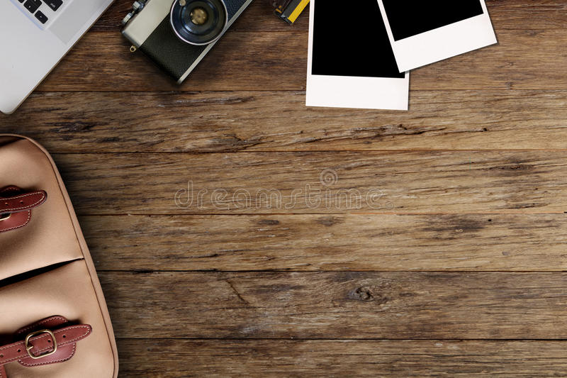 Hipster freelance photographic equipment on a wooden desktop royalty free stock image