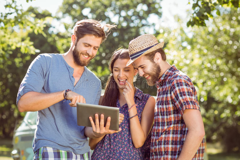 Hipster friends looking at their selfie royalty free stock images