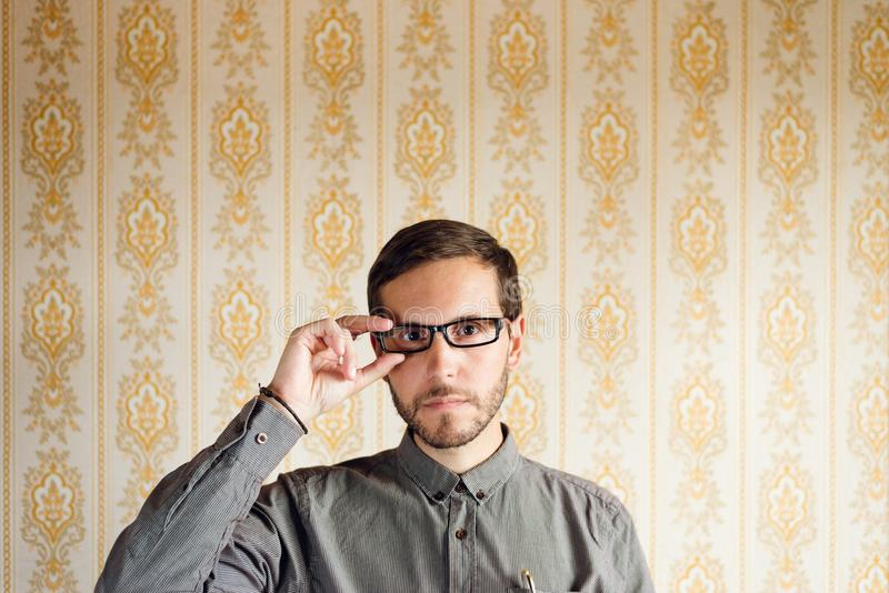 Hipster geek with glasses portrait stock images