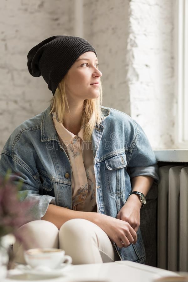 Hipster girl in black cap stock photography