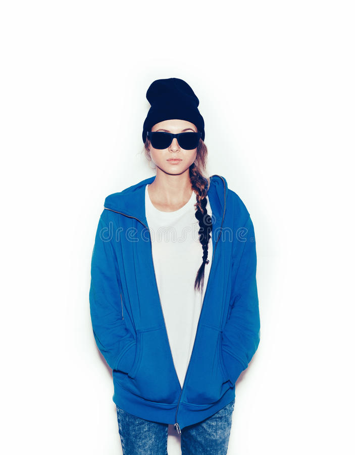 Hipster girl in blue hoodie and black beanie. Against white background, not isolated stock images