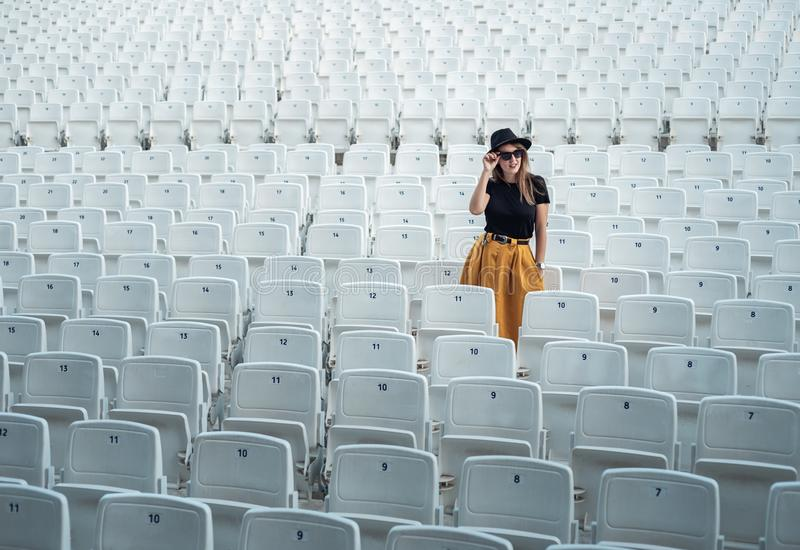 Hipster girl in an empty theater royalty free stock image