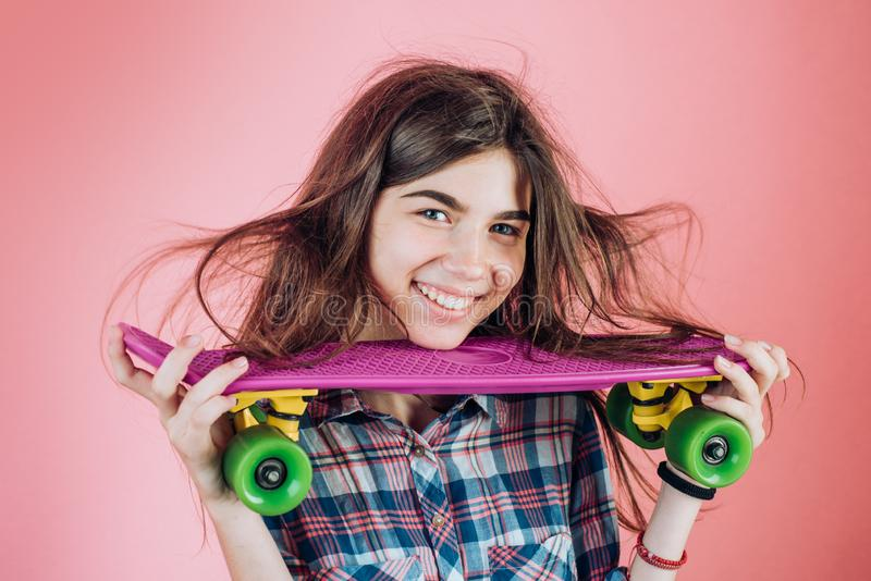 Hipster girl with penny board. ready to ride on the street. Urban scene, city life. skateboard sport hobby. Summer. Activity. plastic mini cruiser board. Spring stock image