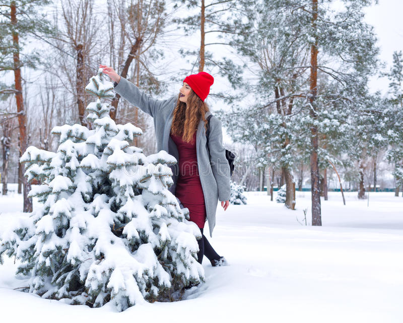 Hipster Girl and tree in winter. stock photography