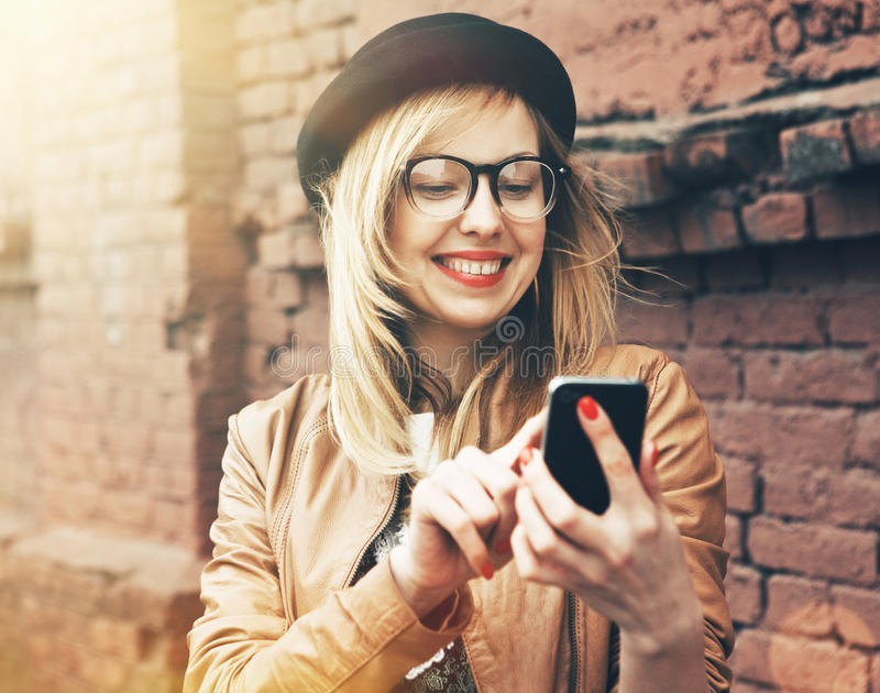 Hipster girl using phone royalty free stock photos
