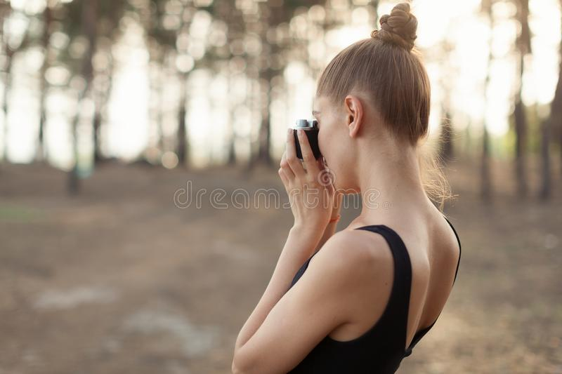 Hipster girl with using vintage photo camera close up, copy space of blank empty mockup, view tourist holding in hands and photogr royalty free stock images