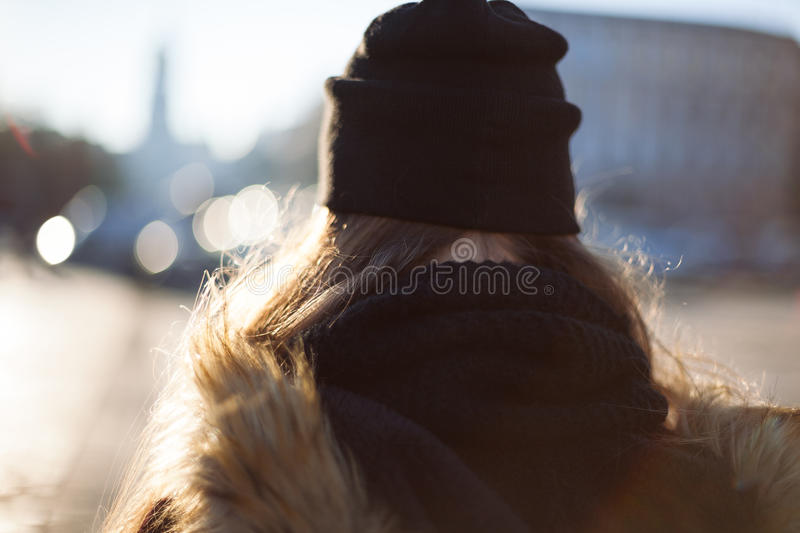 Hipster girl walking on city street royalty free stock photo