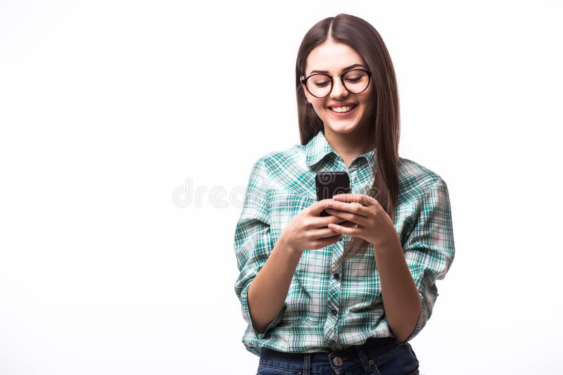 hipster girl wearing glasses and using her smartphone for texting stock images