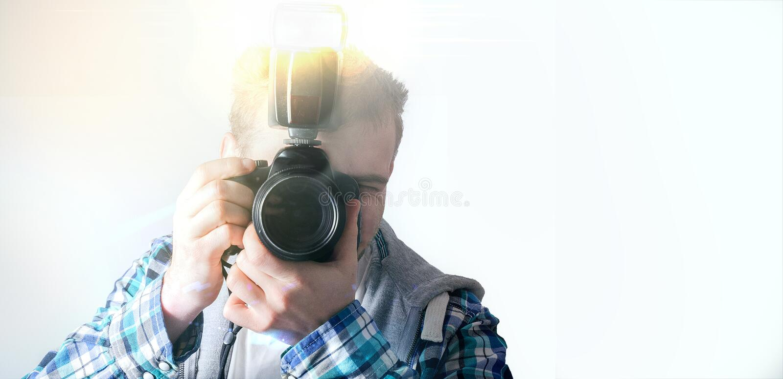 hipster guy with a camera, the photographer on a white background, a freelance designer, stock image
