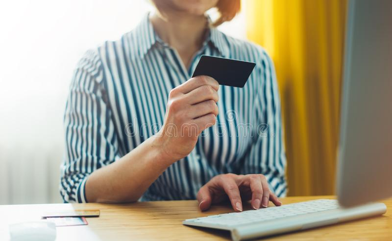 Hipster holding in hands credit card, women shopping online purchase. Hipster holding in hands credit card, woman shopping online purchase, enjoy to buy internet royalty free stock photo