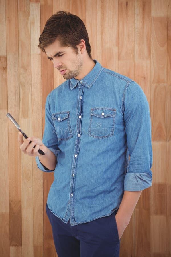 Hipster holding straight edge razor stock photo