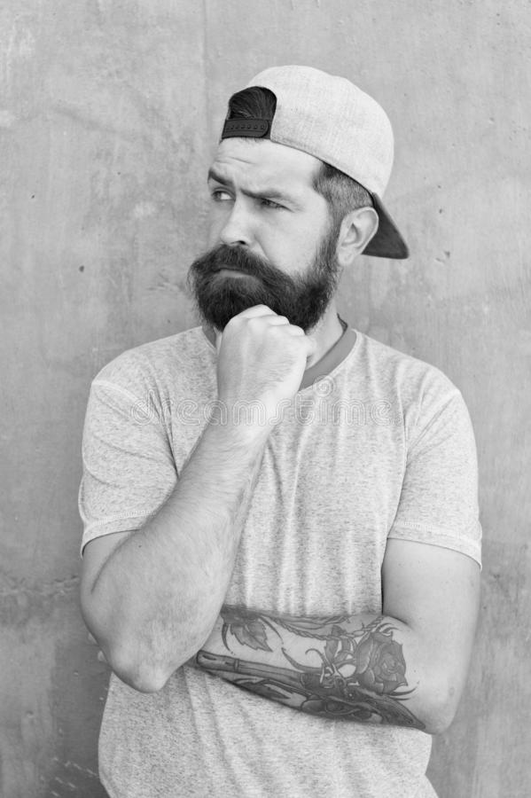 Hipster lifestyle. Brutal handsome mature hipster tattooed man. Bearded man trendy style. Beard and mustache grooming stock image