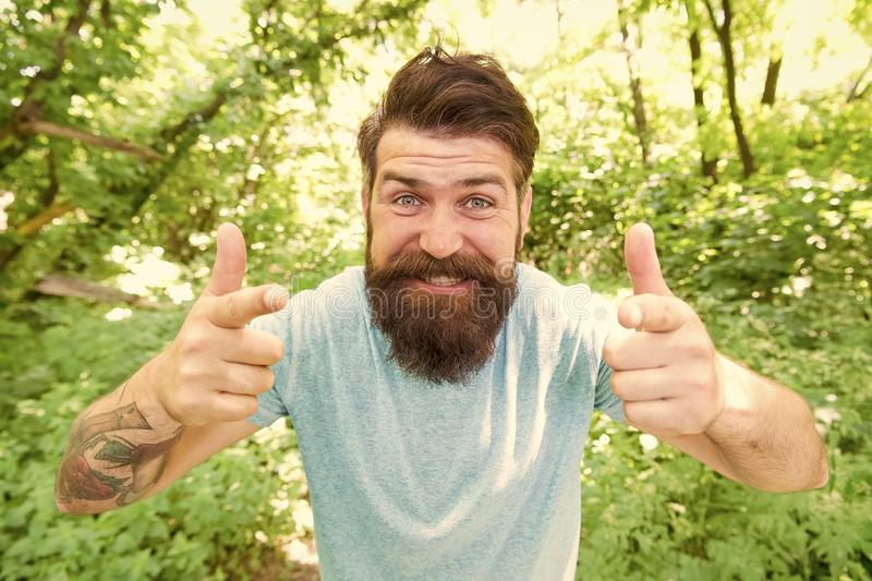 Hipster with long beard emotional face close up nature background. Go wild. Hair care male beauty. Summer fun. Bearded royalty free stock image