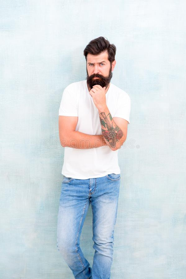 Hipster long well groomed beard and mustache. Casual style daily life. Male temper brutality. Brutal macho casual outfit. Gray background. Simple and casual stock images