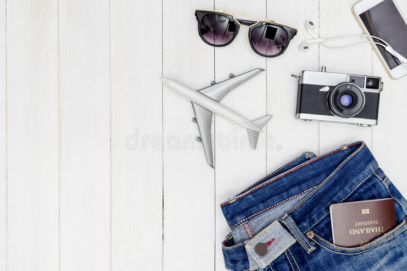 Hipster male travel objetcs and fashion on white wooden. Copy space royalty free stock photography
