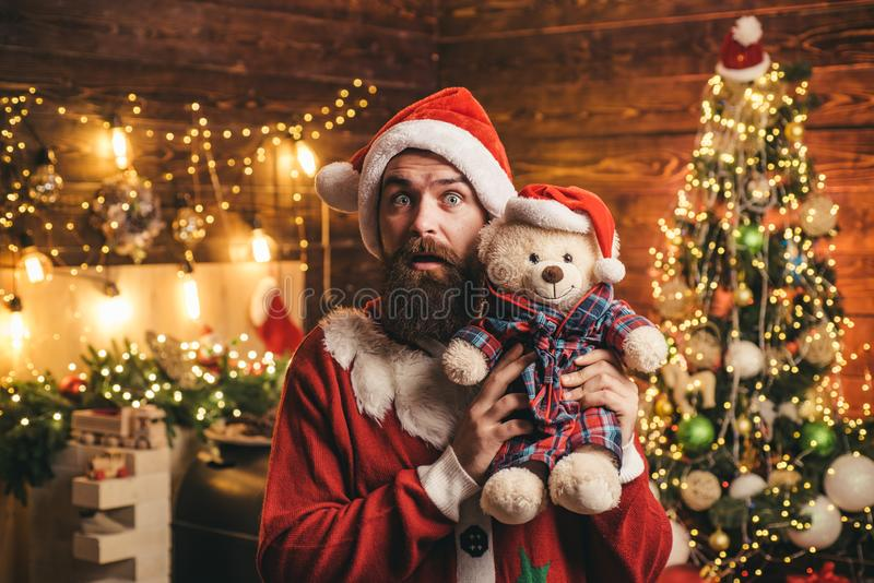 Hipster man, bearded Santa celebrate Thanksgiving day and Christmas. Bearded man in Christmas sweater. Home Christmas stock photography